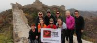 Team photo with the Huma banner on the Great Wall of China | Ayla Rowe