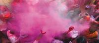 Powders and paints thrown liberally into the air to celebrate Holi Festival | David Lazar