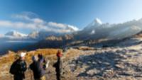 The group enjoys the view of Annapurna South from Kopra Ridge |  <i>Joe Kennedy</i>